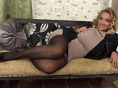 Elegant blonde MILF babe Krystal strips and leaves the high heels on
