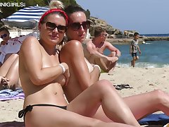 Two sexy exhibitionistic babes are flaunting their assets shiftless