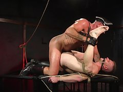 Gay slave endures rough anal in BDSM sexual congress play