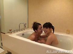 Salacious lesbian girls ask pardon out erotically at the bath till they orgasm