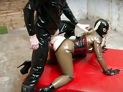 Spitfire in latex costume, full fetish anal display in doggy