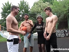 Mature nympho Agatha seduces three guys on the basketball court