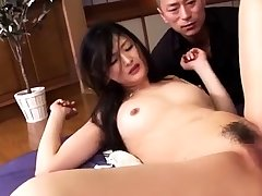 Busty oriental babe jizzed on during a hardcore threesome