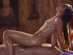 Oiled woman rides the big dick and fucks until the orgasm