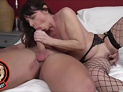 Operative bedroom sex for a mature in sexy fishnets