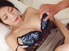 Busty Asian darling gets fucked between tits and gives head